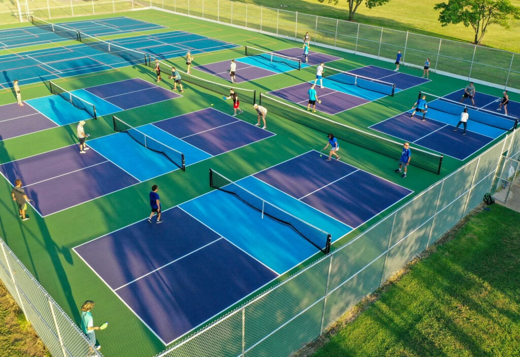 birds view of pickleball courts with multiple players enjoying the game